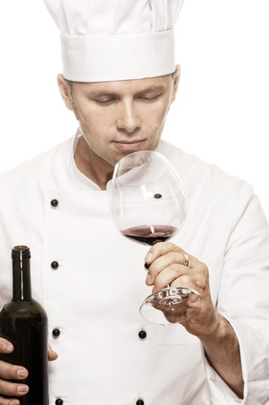 toque blanche: Chef smelling the taste of red wine