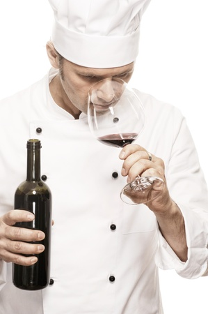 toque blanche: Chef smelling red wine