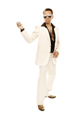 crazy man: Mad disco dancer in white suit and snake leather boots