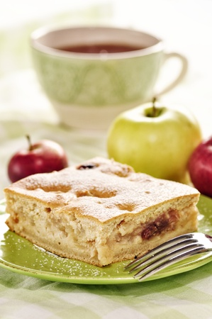 Apple cake on a green plate