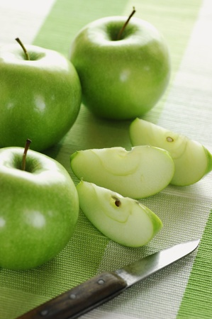 sliced green apples and knife, selective focus Stock Photo