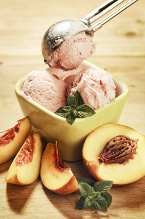 Strawberry Ice Cream With Mint And Peaches Stock Photo