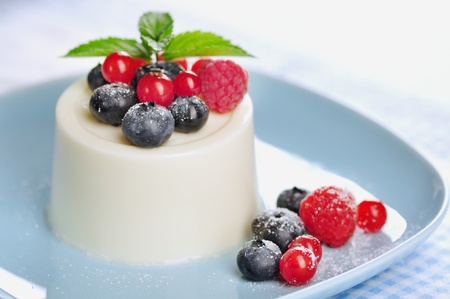 Panna cotta with fruits and mint, selective focus