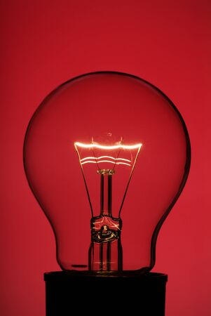 Light bulb with red background photo