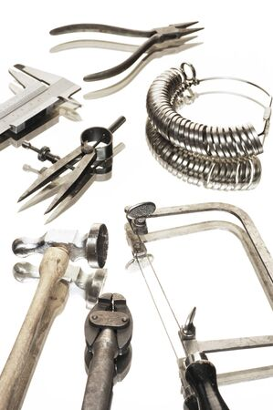 different goldsmiths tools on white background