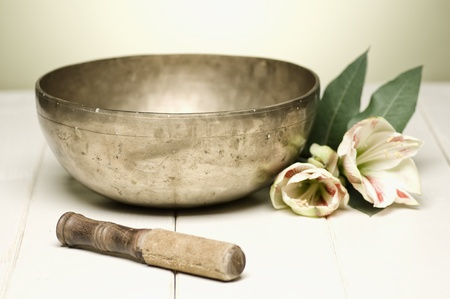 vibrations: singing bowl on a white table, selective focus Stock Photo