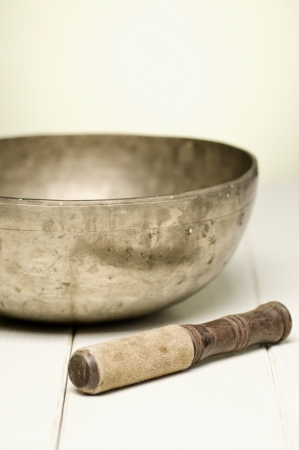 singing bowl on a white table, selective focus Archivio Fotografico