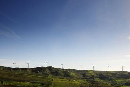 Wind generators, windmills,  on a mountain reign photo