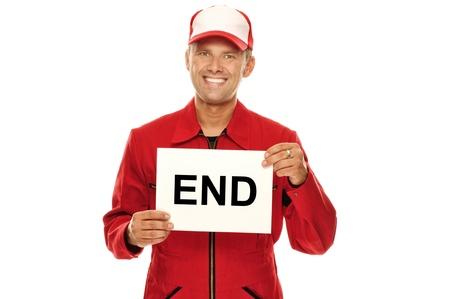 """Üzerinde """"End"""" ile bir işareti tutan kırmızı Overall Mechanic, beyaz üzerine izole"""
