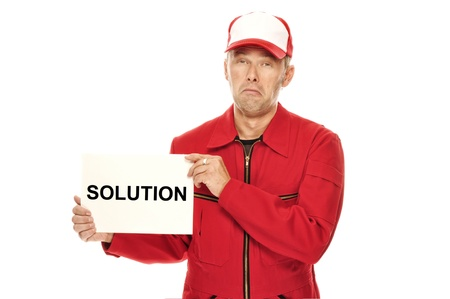 whining: Mechanic in red Overall wth whining face expression and Solution sign. Who needs a solution? I´d like to keep my problem. Stock Photo