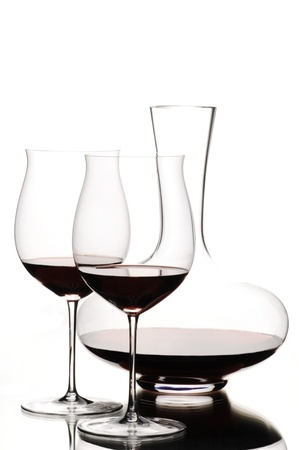 decanter: Red wine and decanter on white background