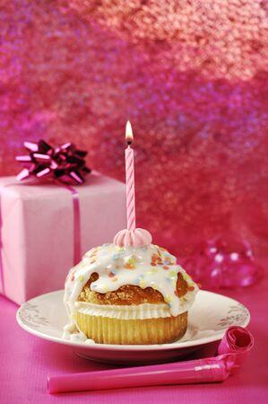 Birthday Muffin On Pink Background photo