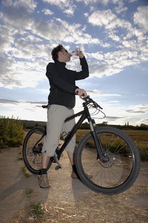 electrolyte: Mountain Biker drinking water