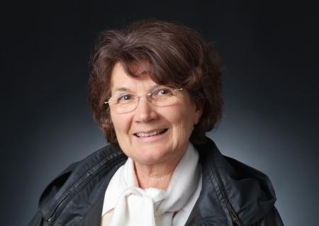 crinkles: Portrait of a senoir lady - giving a smile Stock Photo