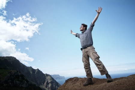 Man reaching out for the sky Stock Photo
