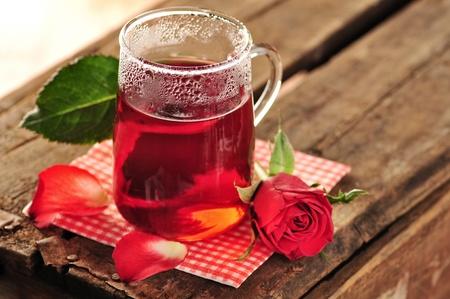 Rose tea in glass mug, rose and petals  Stock Photo
