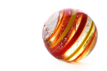 Striped glass marble on white photo