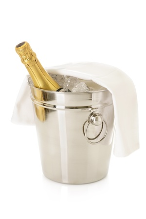 Bottle of Champagne in cooler filled with ice-cubes, isolated on white Stock Photo