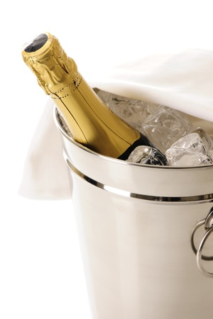 icecubes: Bottle of Champagne in cooler filled with ice-cubes, isolated on white Stock Photo