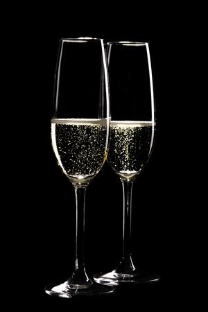 Two glasses of sparkling champagne infront of black background Archivio Fotografico
