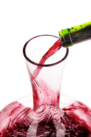 Red wine being poured in a decanter, selective focus Stock Photo