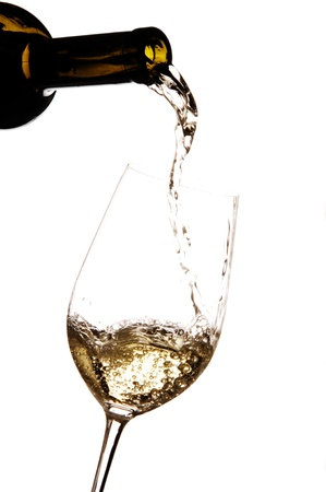 White wine being poured into a glass