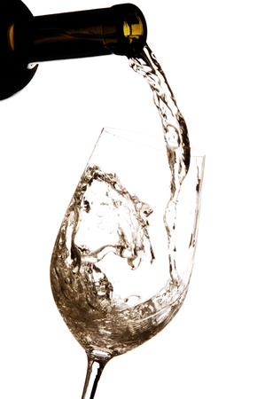 white wine glass: White wine being poured into a glass