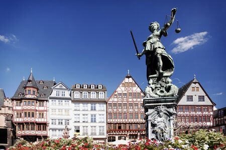 Justitia on the Römerberg Frankfurt, Germany. This is the historic center of Frankfurt. photo