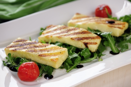 starter: Grilled Halloumi cheese on rocket salad Stock Photo