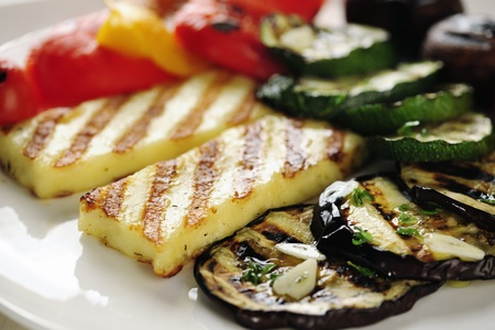 Grilled Halloumi cheese and vegetables; close-up   selective focus photo