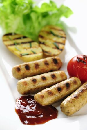 ketch: Grilled sausage and potatoes with ketch-up Stock Photo