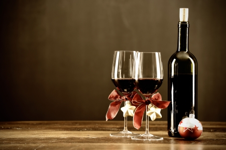 Red wine, bottle and christmas ornaments, selctive focus Stock Photo
