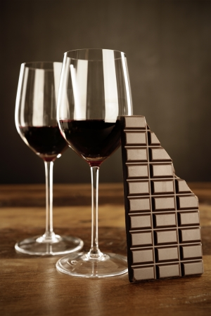 Red wine and chocolate bar, selective focus