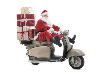 Santa Claus on vintage scooter with stack of christmas presents, isolated on white Archivio Fotografico