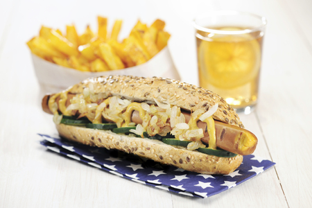 Healthy Homemade Vegan Hot Dog (vegan Tofu sausage and no cheese)  with French Fries and Ice Tea, selective focus Stock Photo