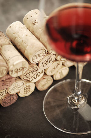 cohort: Corks of different years and red wine, selective focus Stock Photo
