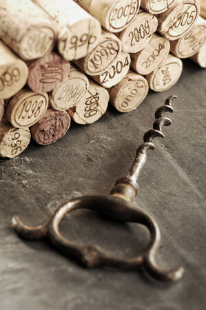 cohort: Corks of different years and corkscrew, selective focus Stock Photo