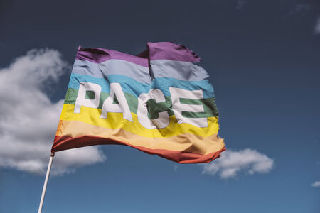 peace flag: Pace, Peace Flag waving against blue sky with some nice white clouds