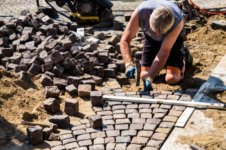 Stone setters, road construction, paving stones Stock Photo