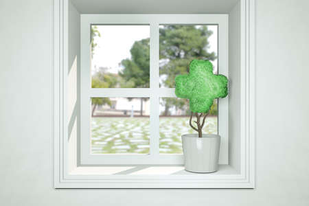 Small plant in pot on window as a plant shaped cross at sunny day. Healthcare medical or first aid concept