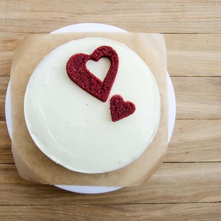 red velvet: red velvet cake with hearts on wooden background Stock Photo