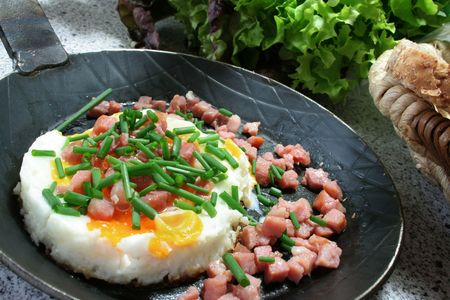 a frying pan with fried egg and ham photo