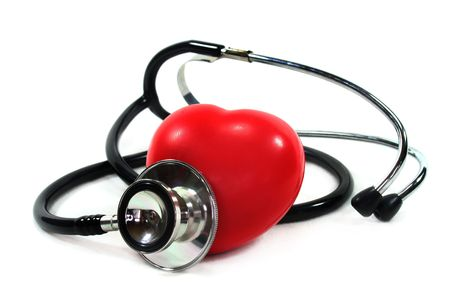 palpitations: Stethoscope with heart on white background