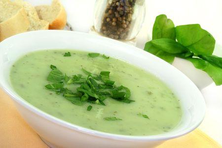 Herb soup garnished with fresh sorrel photo