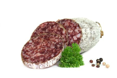 air dried salami: Salami with peppercorns and fresh parsley on a white background