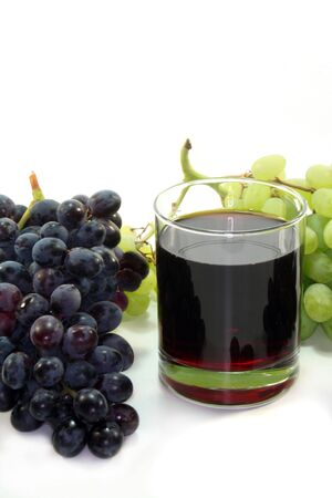 and grape juice: a glass of grape juice with a light and dark grapes