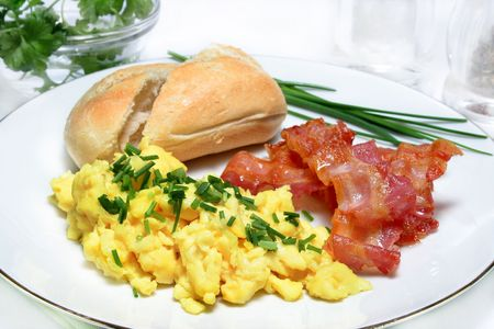scrambled: Scrambled eggs with bacon and bread