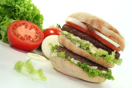 double hamburger with fresh tomatoes, onion and lettuce photo