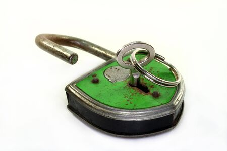 old padlock with key on a white background photo