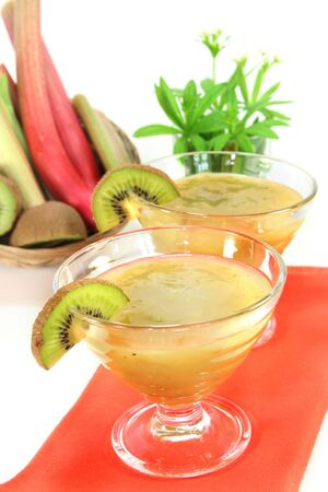woodruff: Green jelly with kiwi fruit, rhubarb and sweet woodruff Stock Photo